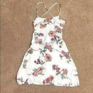 A white Brandy Melville One Size dress.